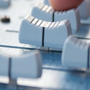 Knobs of a sound mixer, with a hand